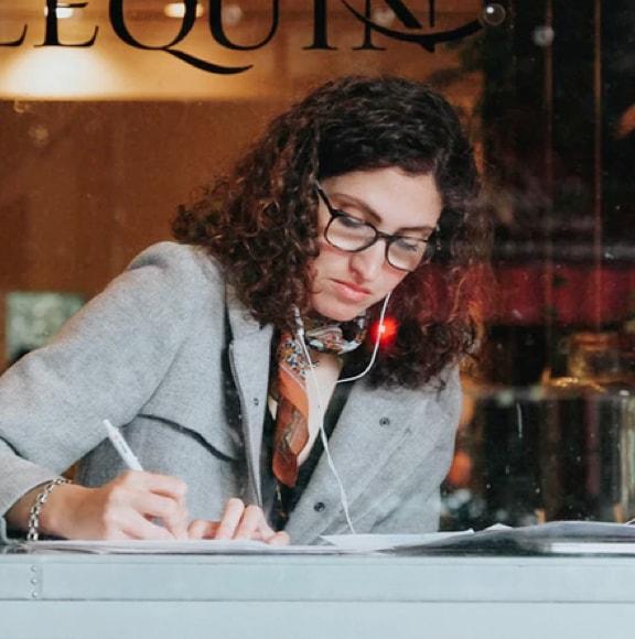 A girl writing something