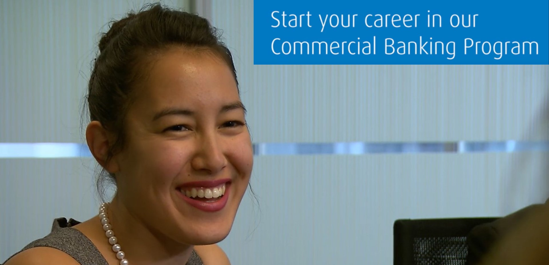 Female employee laughing next to video title