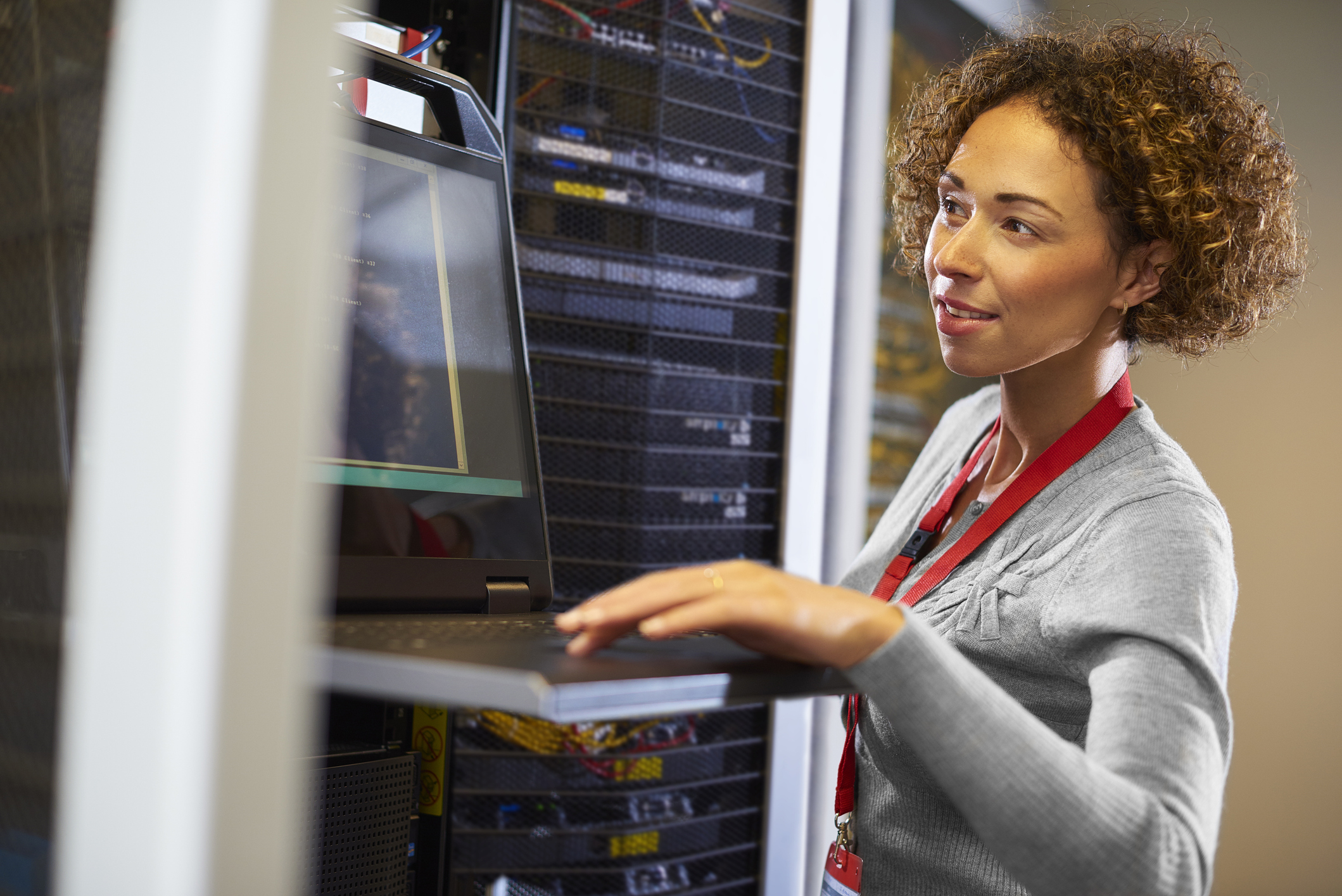 Female IT Professional in a Server Room