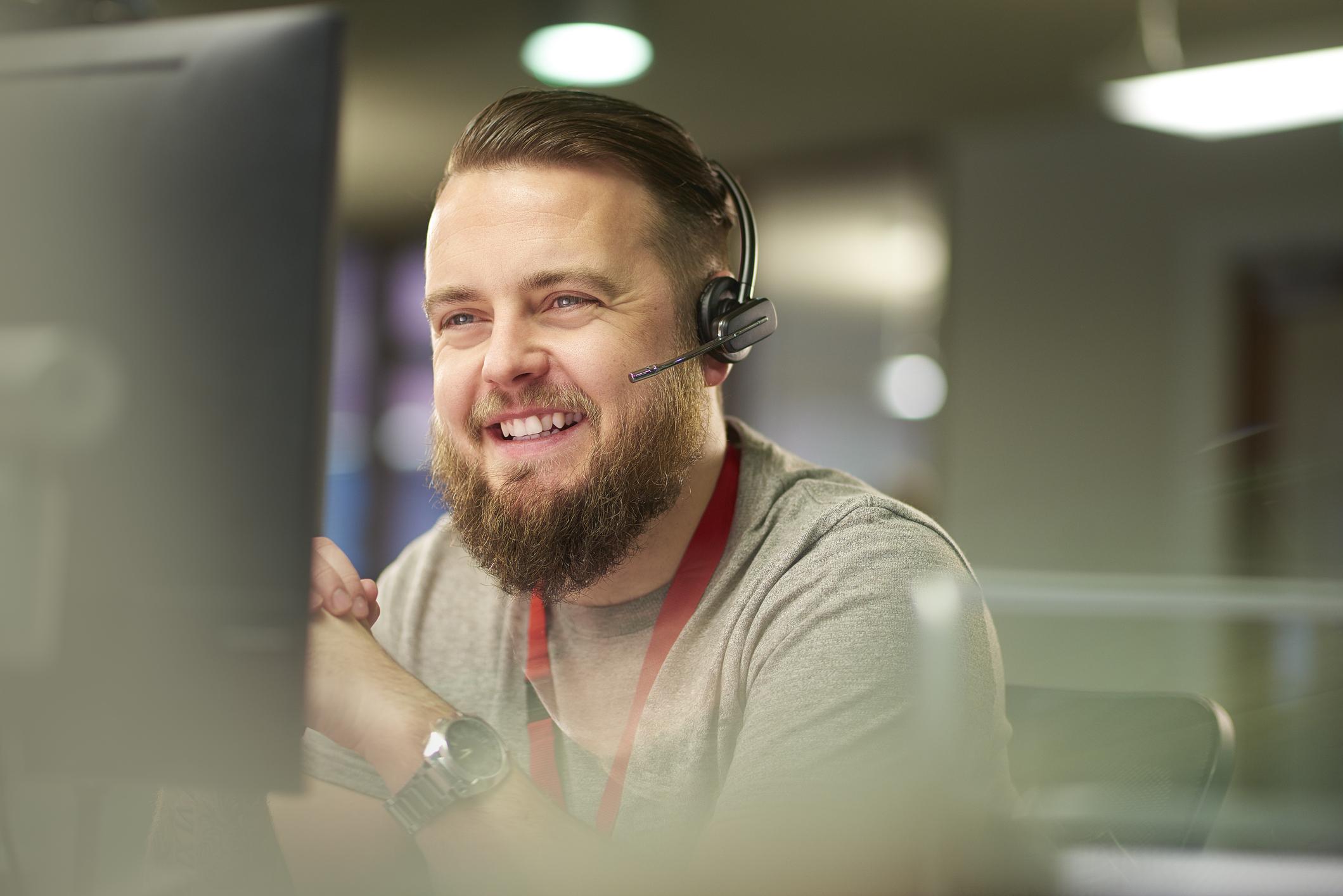 Male customer care representative with headset