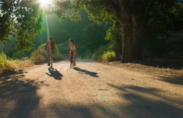 Two people outdoor biking