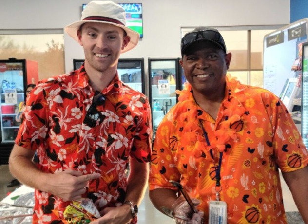 Two Chewy team members in Hawaiian shirts on a themed celebration day