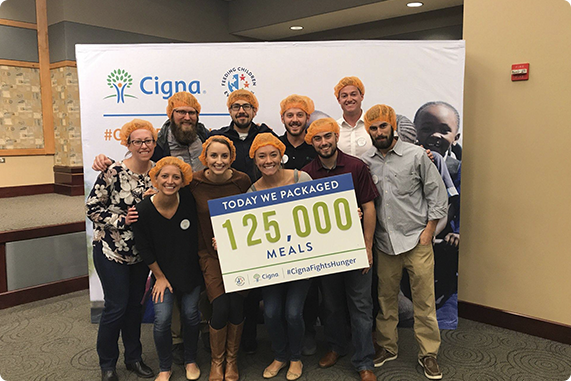 Cigna employees posing for a photo at a company volunteer event.