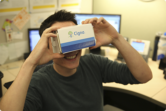 Cigna employee showing off his branded virtual technology.
