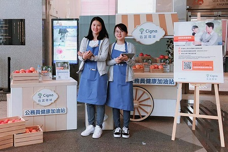 Two Hong Kong employees posing for a group photo.