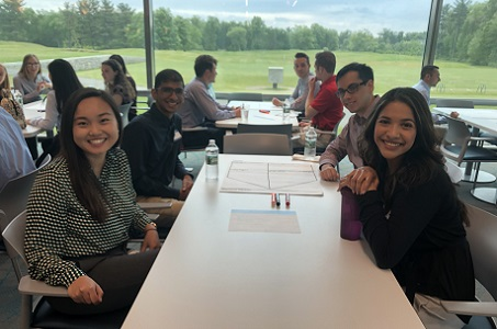 Cigna interns working together on a group project
