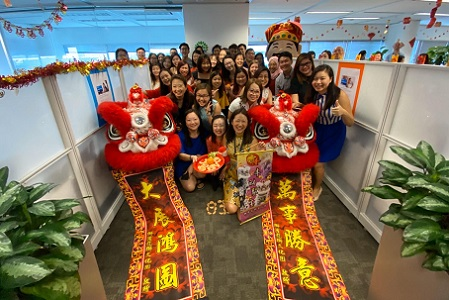 Singapore team members celebrating at the office