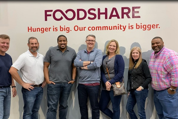 Technology team employees volunteering at Foodshare