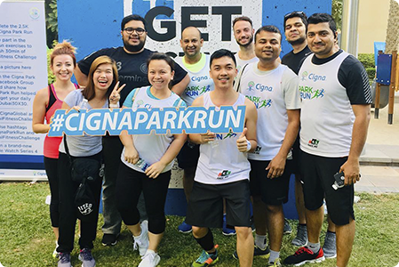 Cigna UAE employees taking part in a community fitness event.