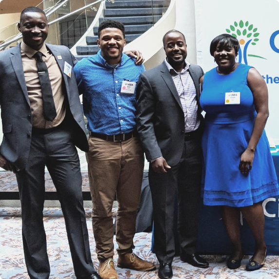 Team Cigna employees posing for a photo at a community event.