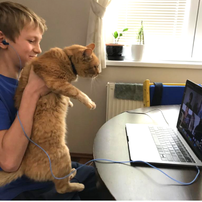 Young employee's son holding cat coworker