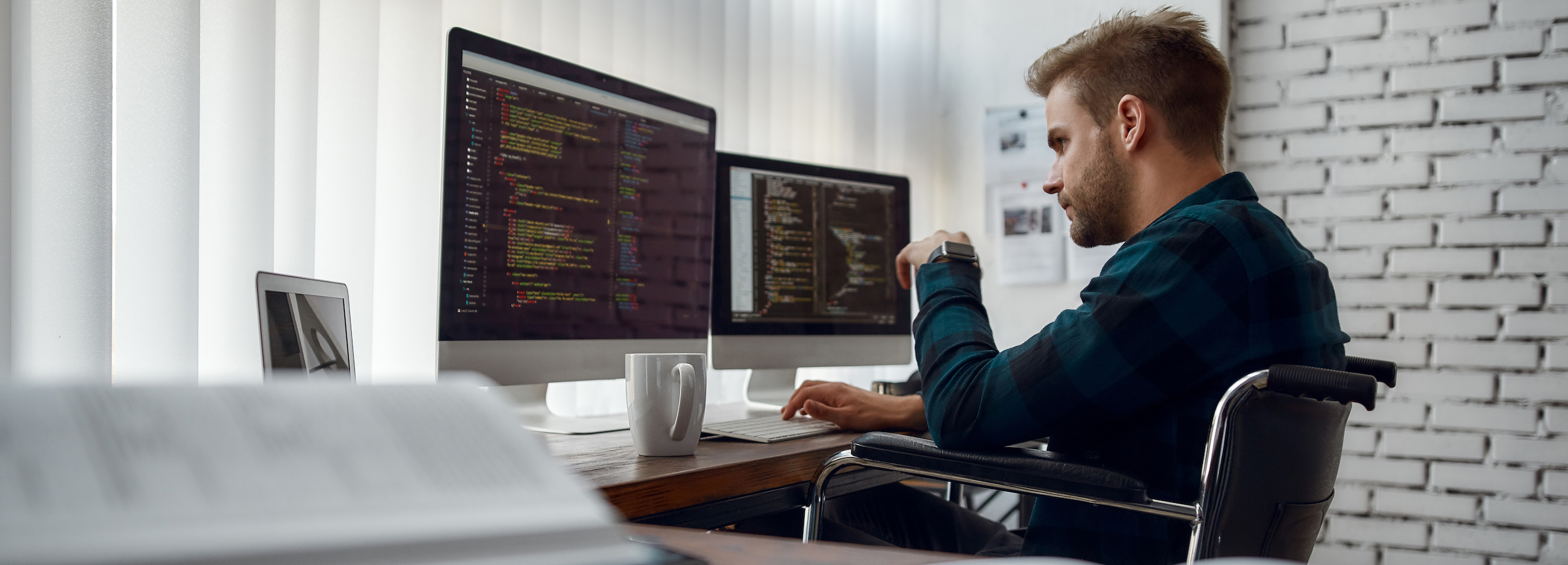 Engineer in wheelchair coding