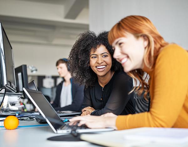 Partnership between two female engineers coding