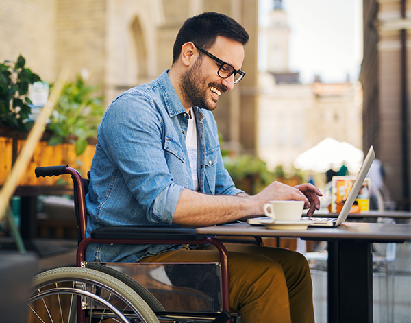 Intern in wheelchair with laptop coding Citrix products