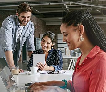 Five team members discussing digital innovation