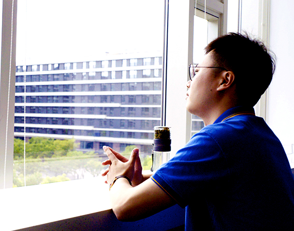 Photograph of Beckman Coulter Diagnostics associate looking out window