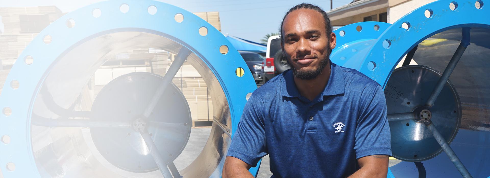 Photograph of McCrometer associate in equipment yard