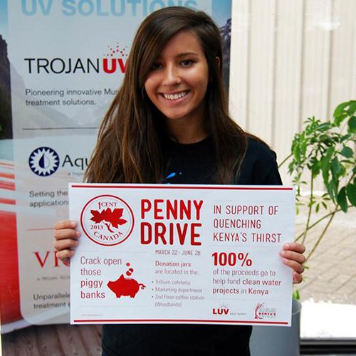 Photograph of Trojan Technologies associate holding charity card
