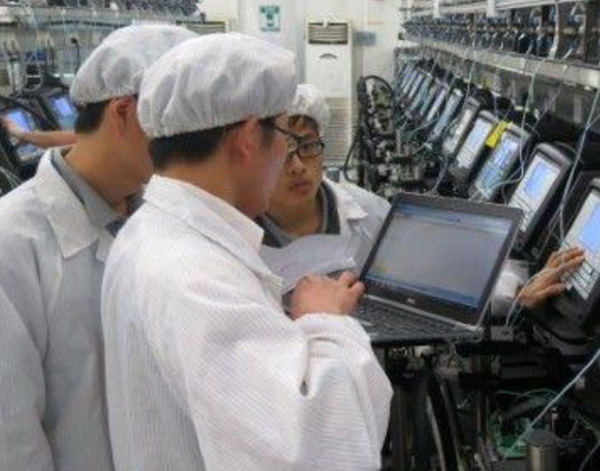 Photograph of Videojet associates in factory