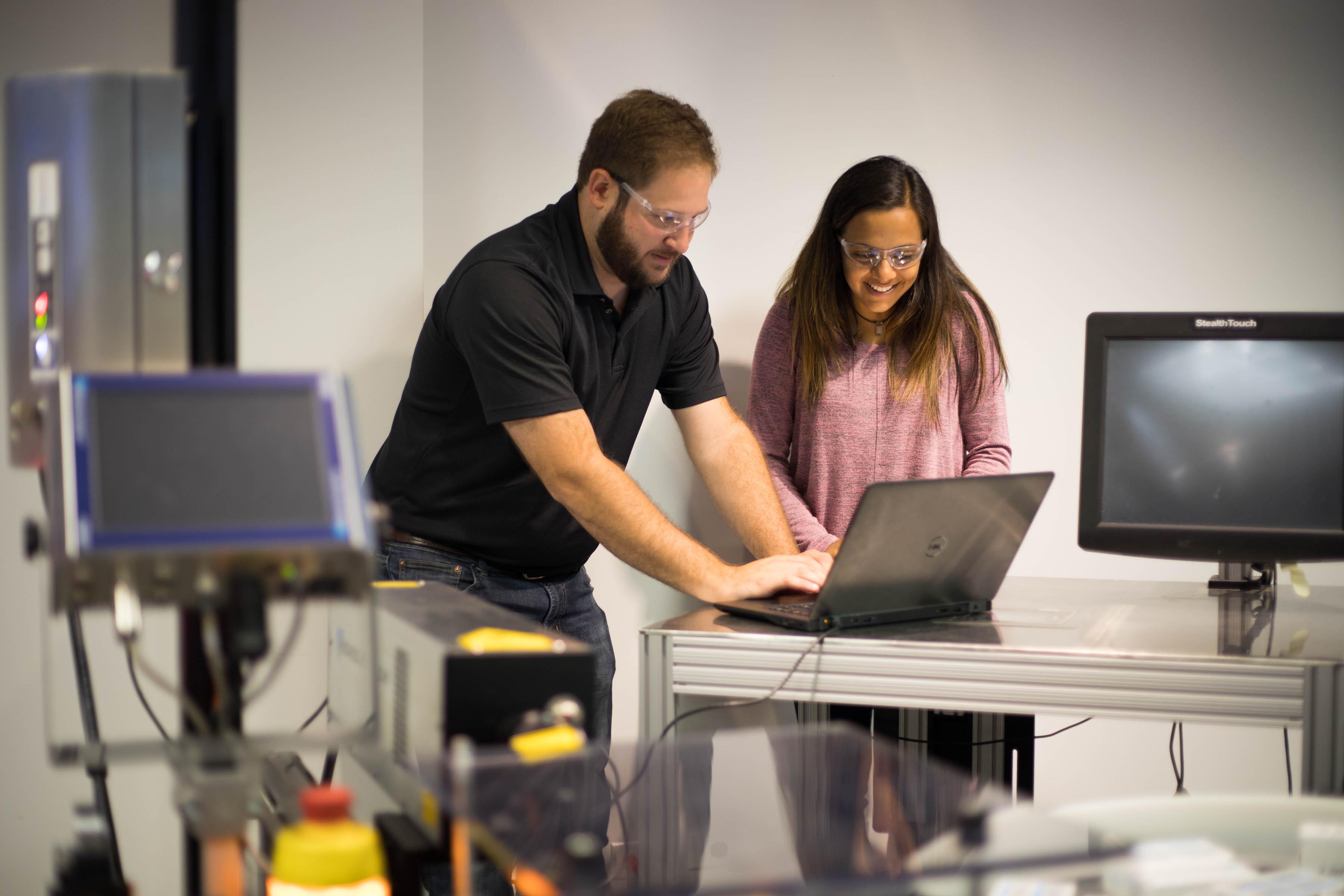 Danaher Digital associates working at a computer