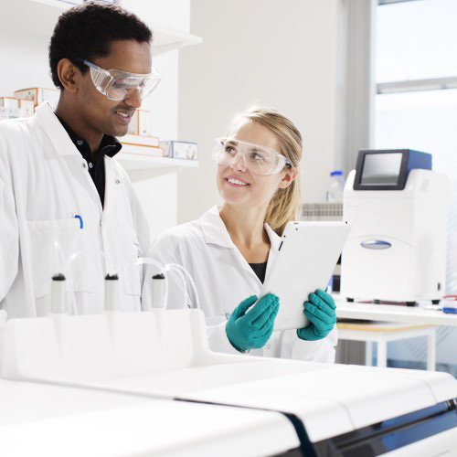 Photograph of Cytiva associates working in a lab