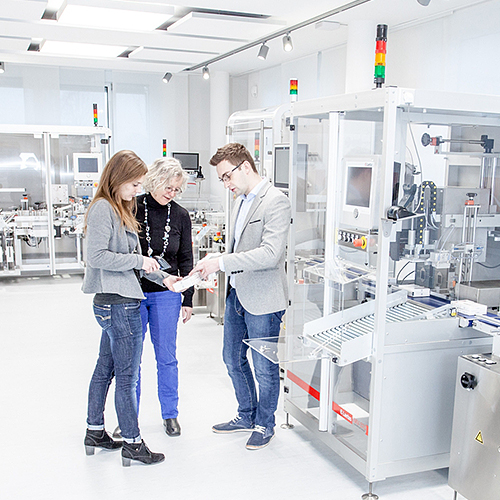Photograph of Laetus associates in quality control lab