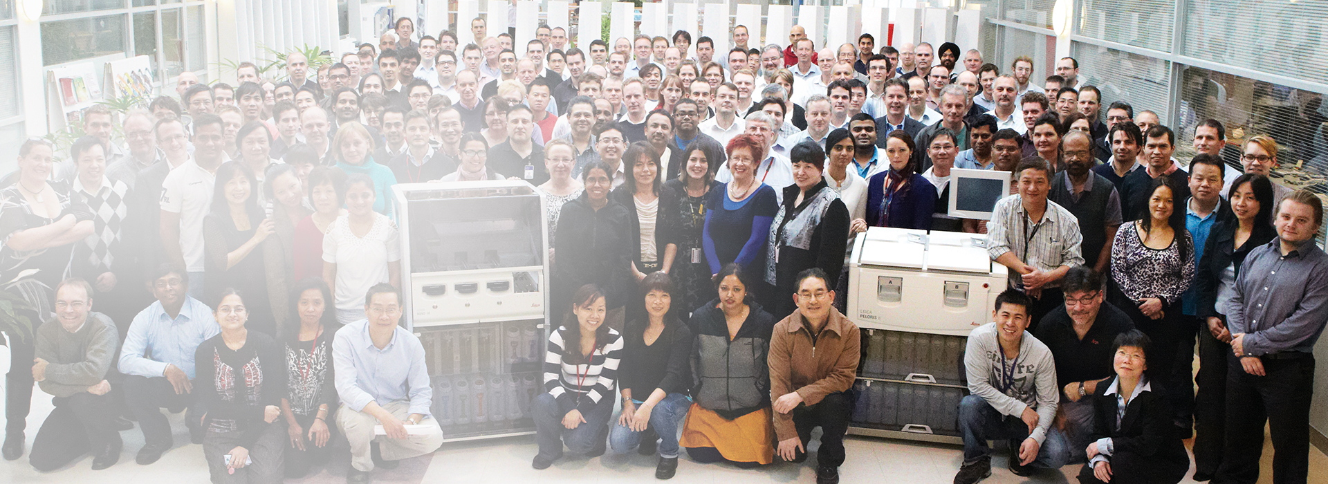 Photograph of Leica Biosystems associates in company square