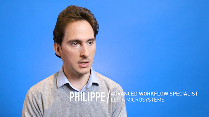 Photograph of Philippe in front of a blue background