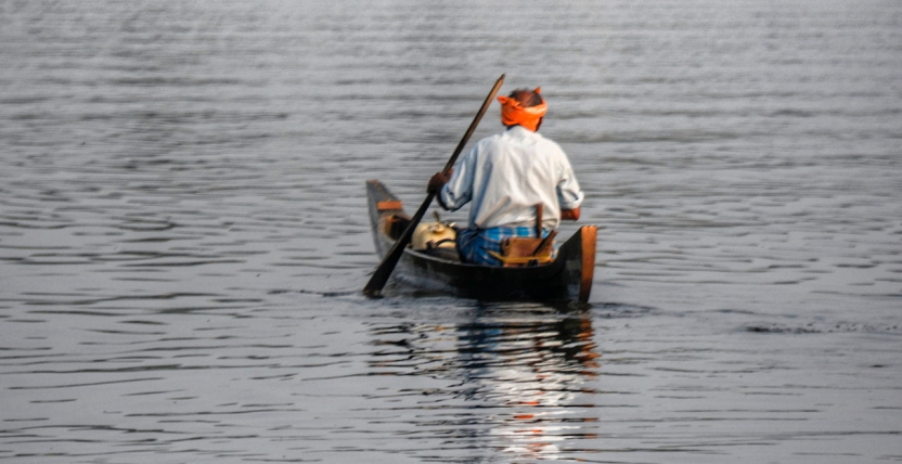 Man in a traditional Indian canoe