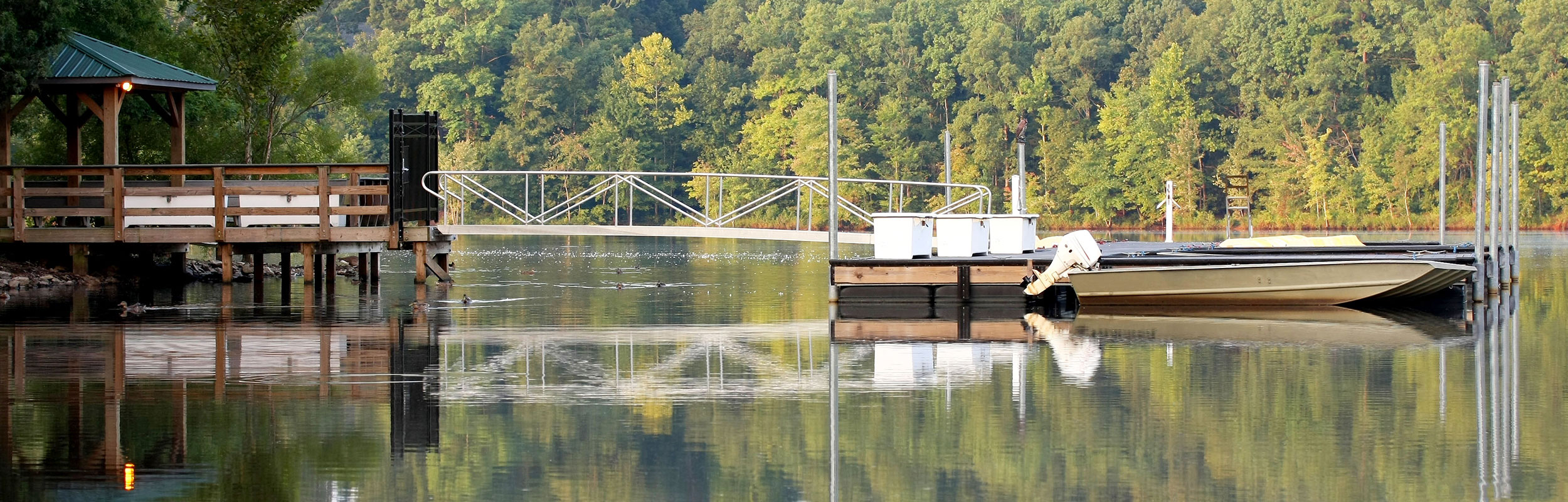 Pier on lake with woods in Cary, North Carolina