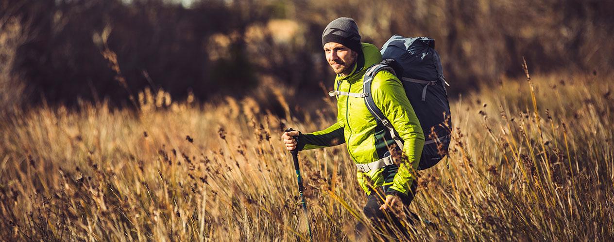 Hiker standing in field