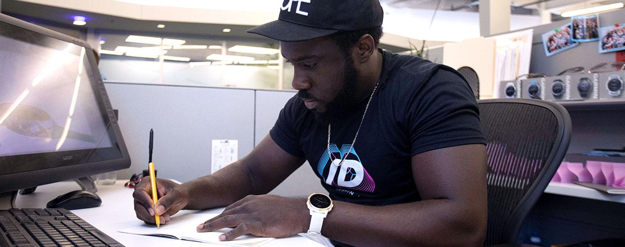 Garmin associate working at his desk