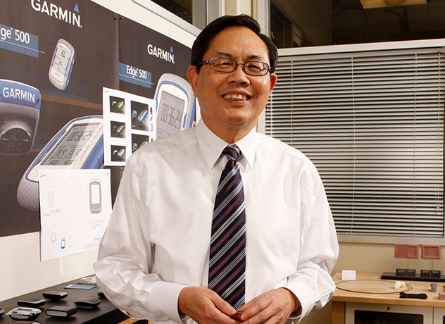 Founder of Garmin Min Kao stands in workspace at Garmin headquarters