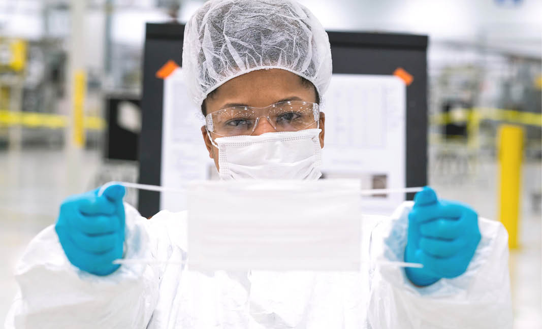 Workers begin final preparation for manufacturing Level 1 face masks Wednesday, April 1, 2019 at the General Motors facility in Warren, Michigan.