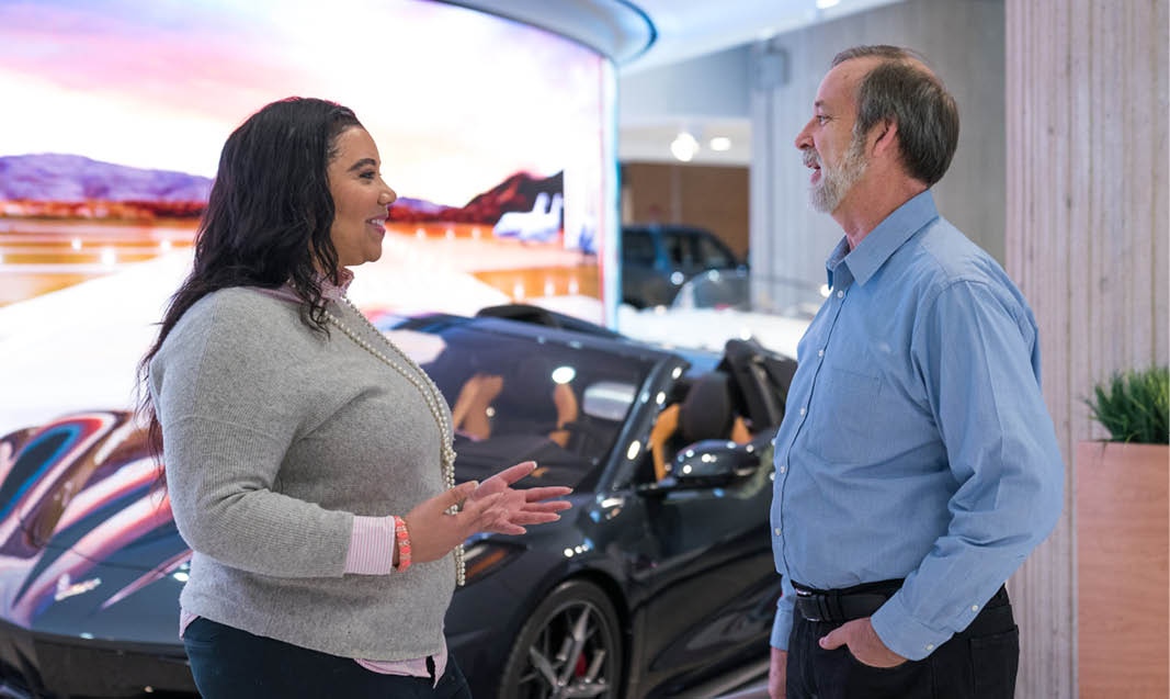 GM employees having a conversation at the Renaissance Center.