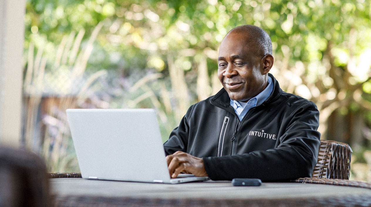 Intuitive Employee sitting with a laptop