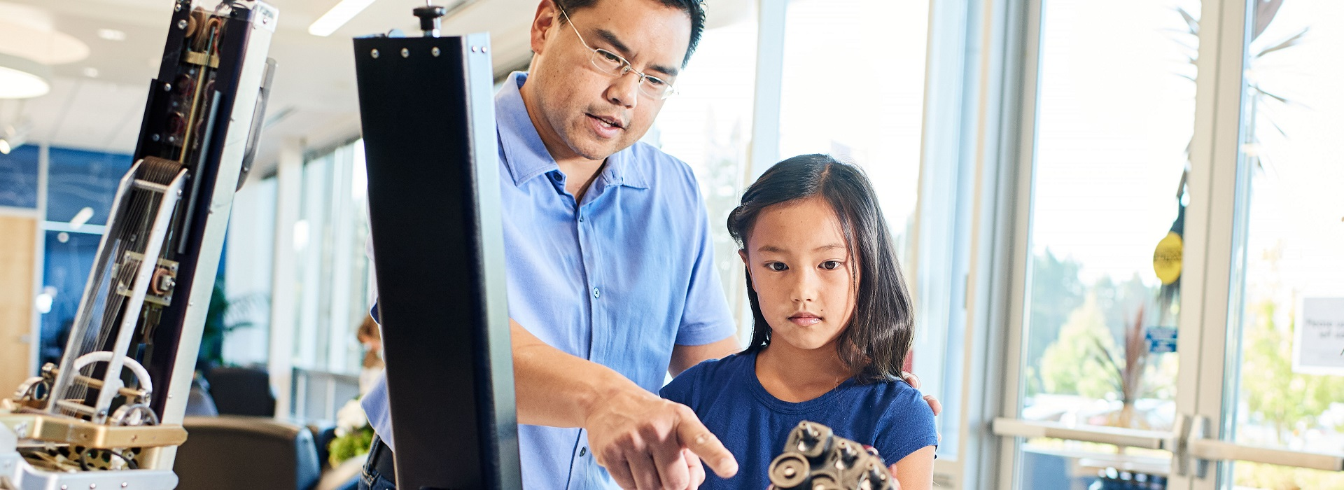 Intuitive senior designer employee with daughter on Bring Your Kids to Work Day