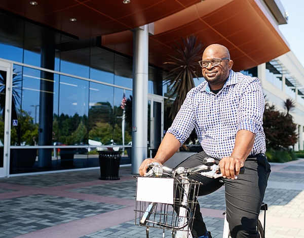 Intuitive employee riding bicycle in front of Sunnyvale headquarters