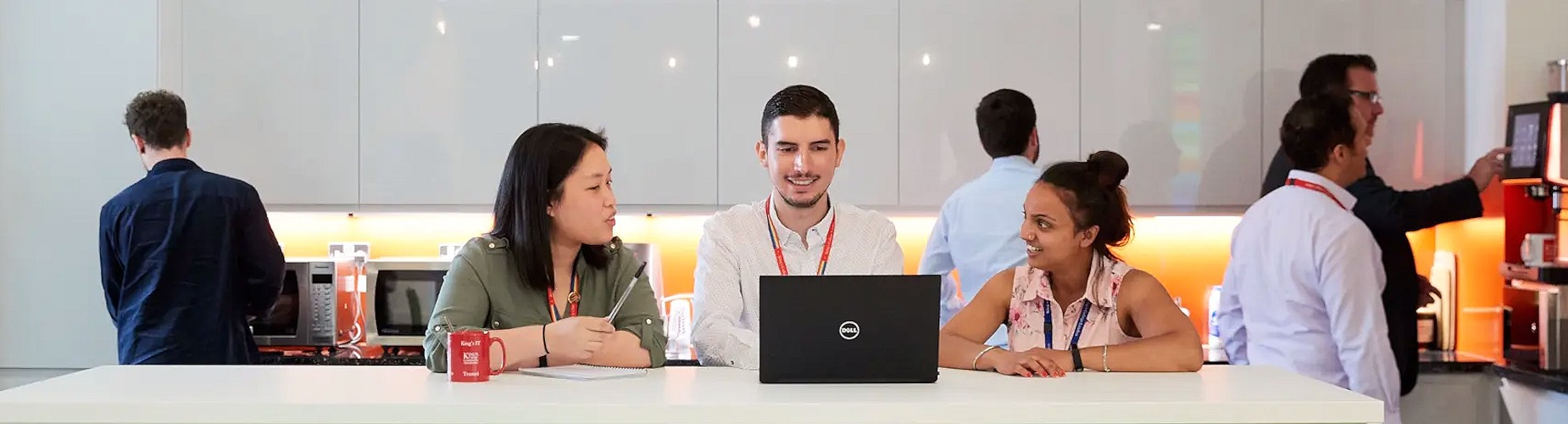 Group of people having a meeting in an office kitchen