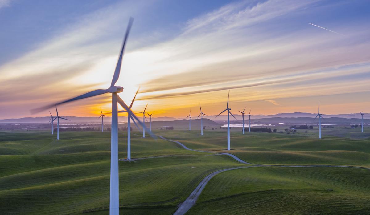 Wind Turbines in a field by RawFilm on Unsplash