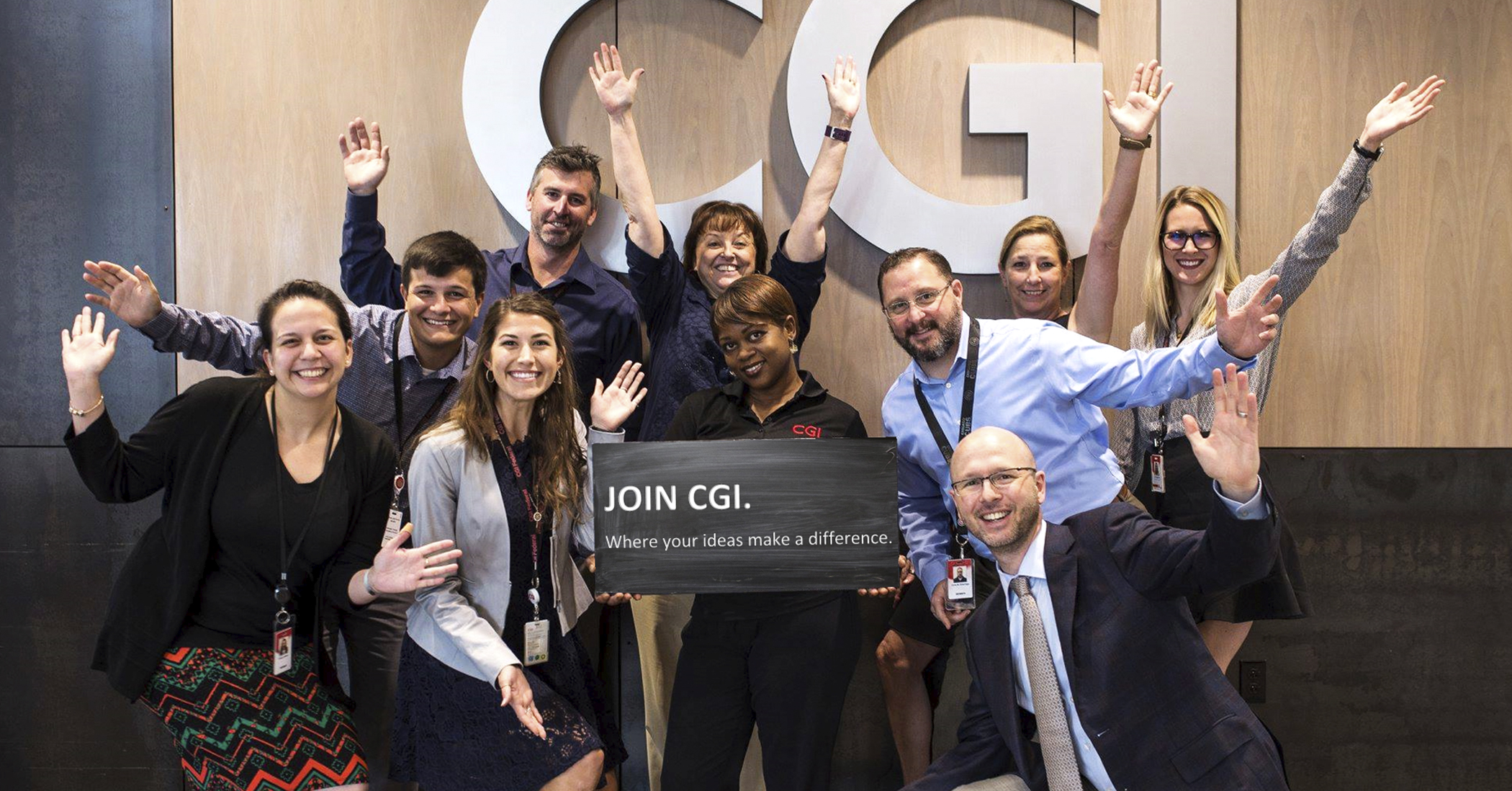 A picture of the CGI team waving and smiling