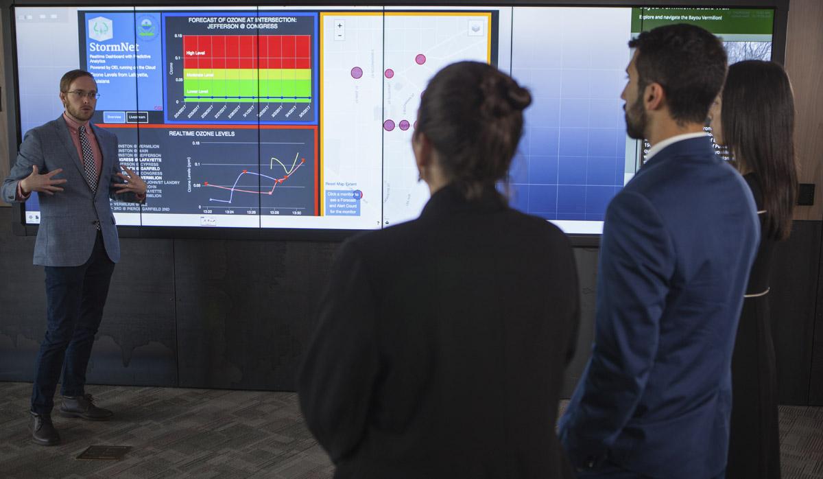CGI employee presenting on a digital display