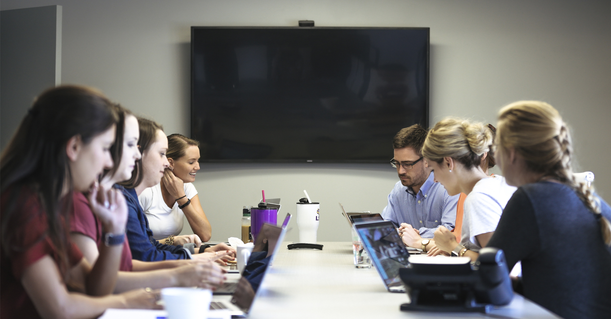 Picture of Click Here Digital team members sitting at a table
