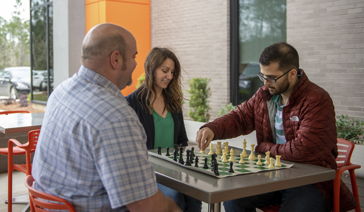 Globalstar employees playing chess