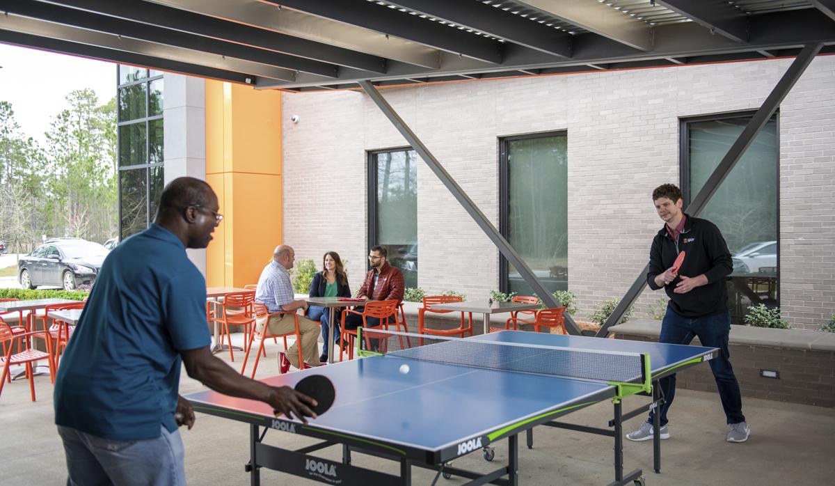 Globalstar employees playing ping pong