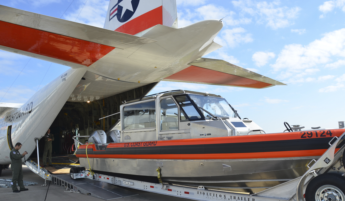 Metal Shark boat being loaded into a Coast Guard Plane