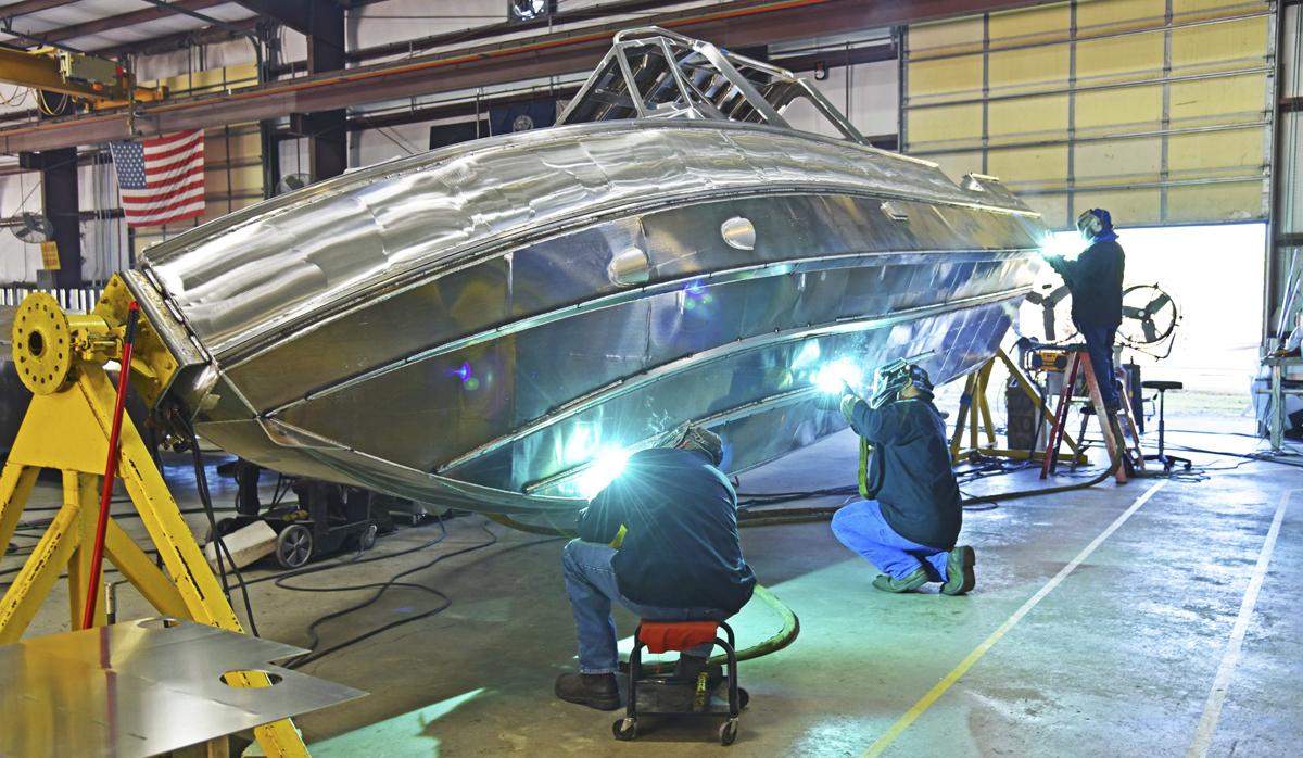 Welders welding a Metal Shark Boat hull