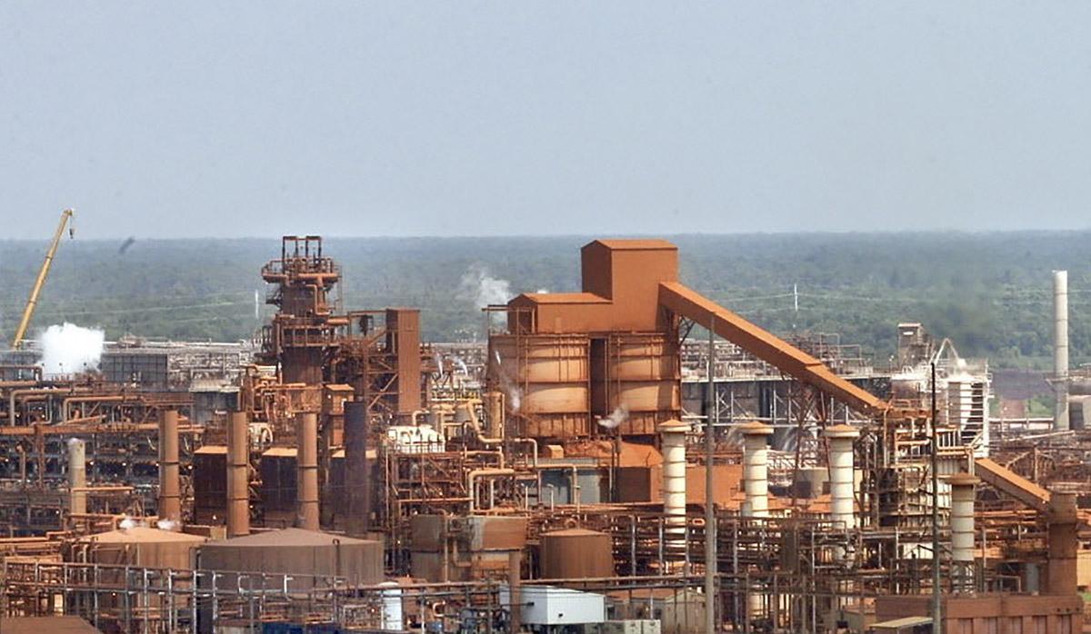 Noranda Alumina Plant with blue sky in background image