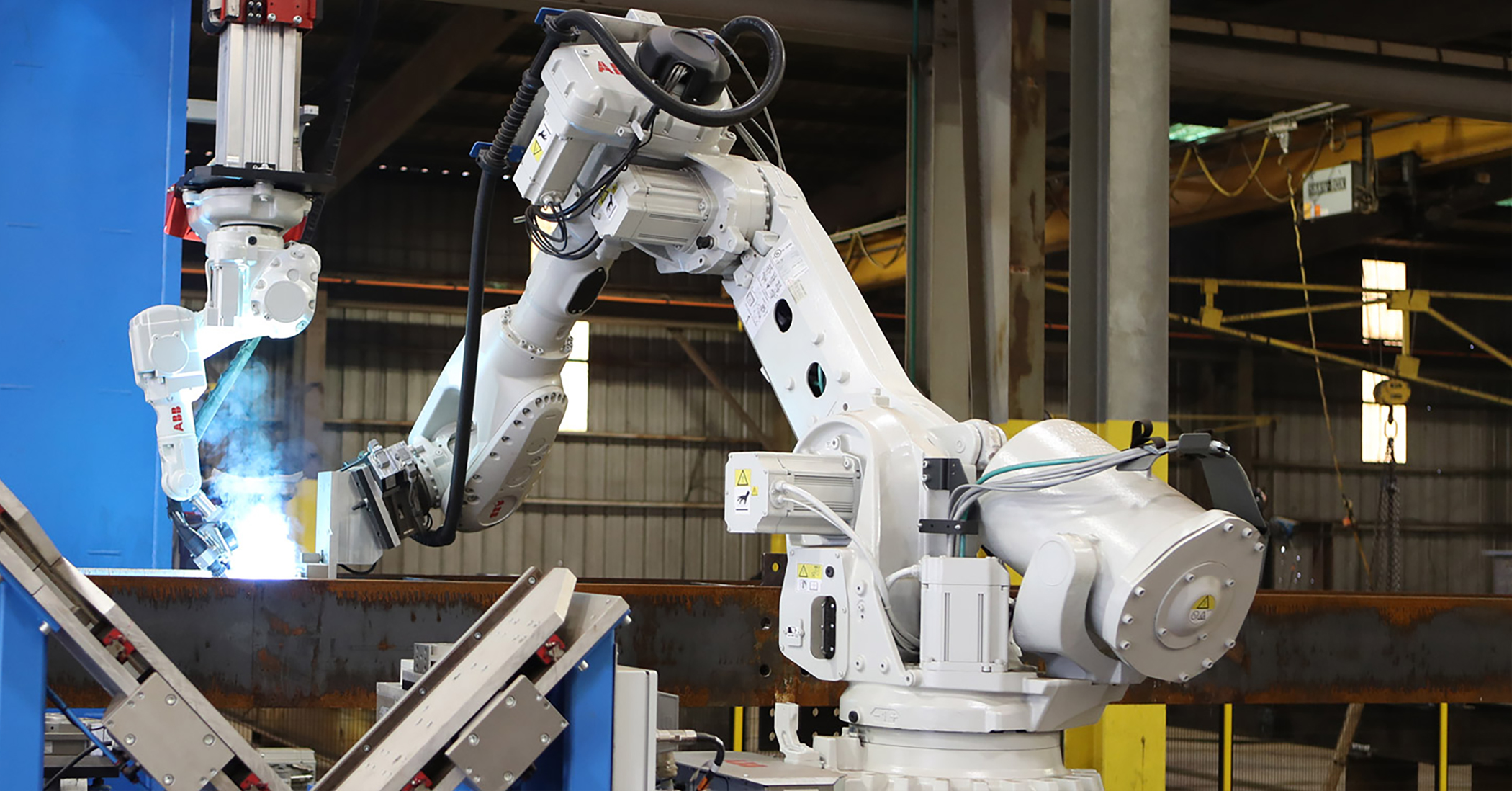 picture of a robotic arm welding steel