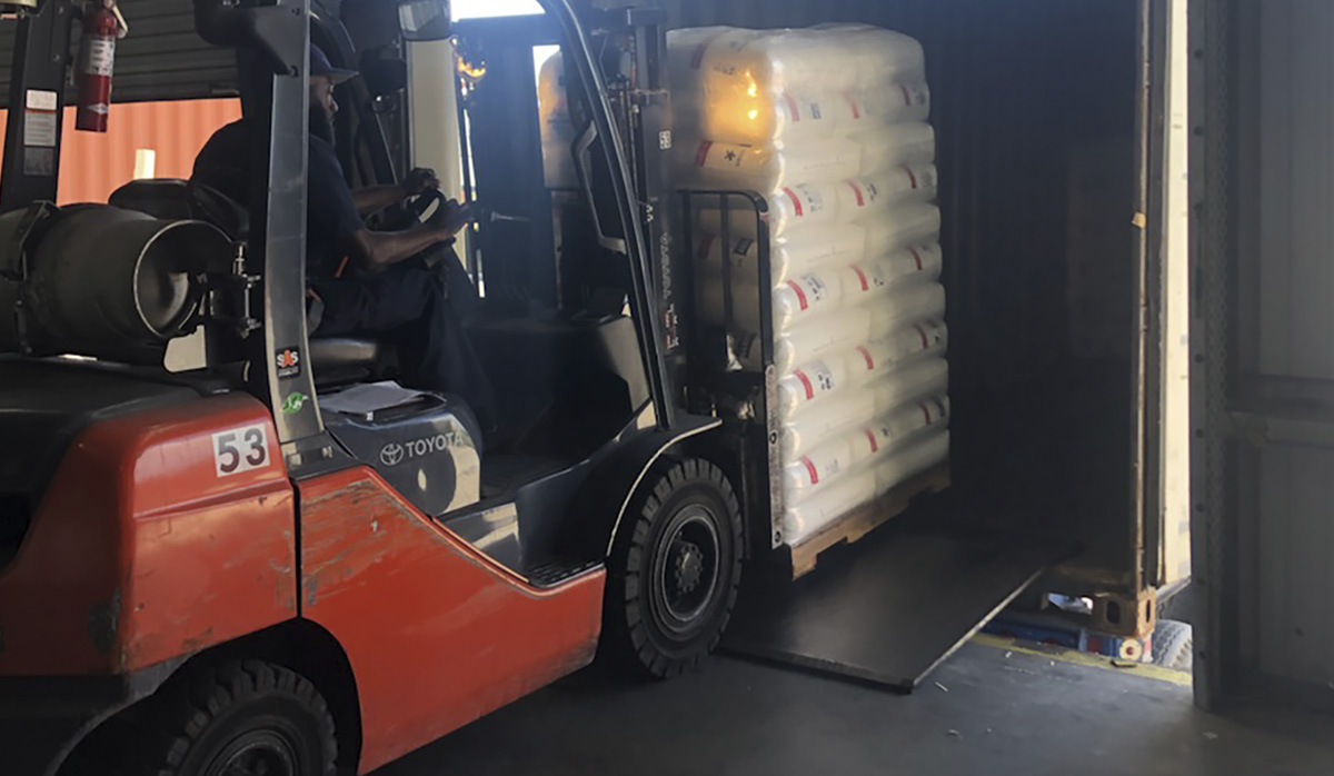 TCI Packaging Employee loading a truck with a forklift